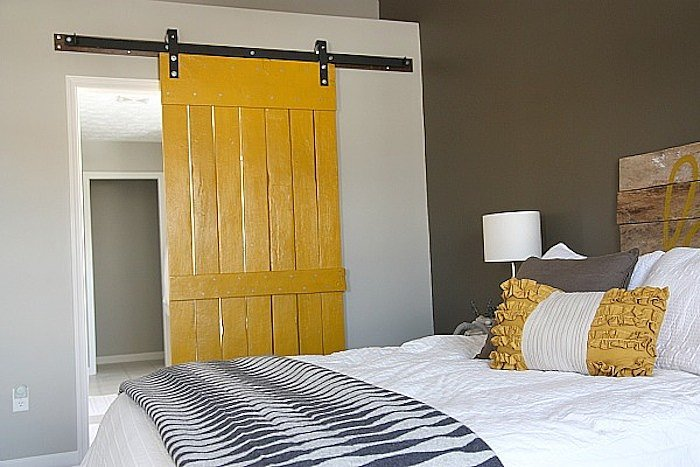 This sliding barn door DIY is brilliant. We love the color too! Source: House Tweaking