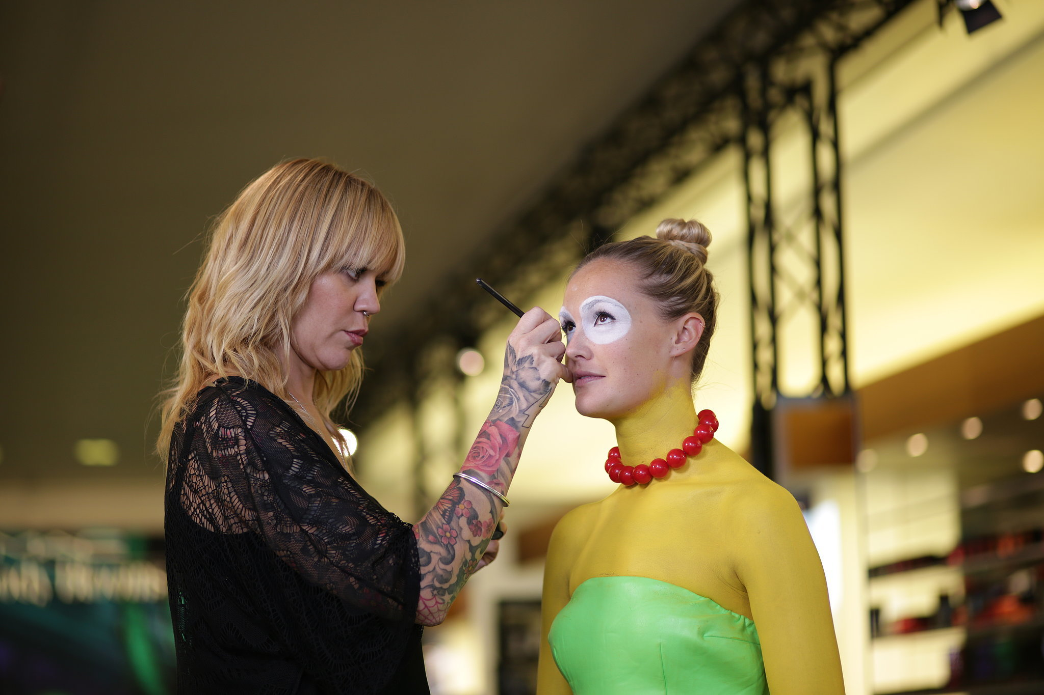 Caroline Donnelly applies water-based paint to her model