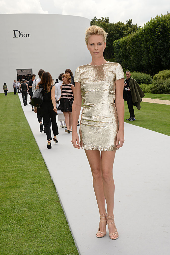 Charlize let her gold mini-sheath dress speak for itself at the Dior Haute Couture show during Paris fashion week.