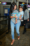 Kim paired her graphic baseball tee with light-wash frayed skinnies and nude, patent-leather slingback heels, making for the most appropriate airport style. Source: FameFlynet / Stoianov/BJJ