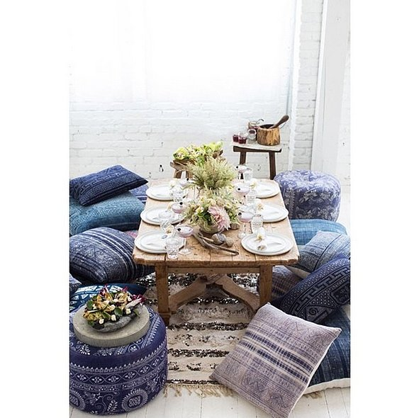 Planning a dinner party? Keep it casual by ditching your traditional table and eating on the coffee table instead. Use comfortable pillows as seats and tuck in for a fun night.   Source: Instagram user boholuxeinteriors