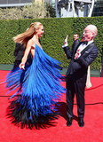 Heidi Klum took a spin in her detailed blue gown, which got a hilarious reaction from her Project Runway costar Tim Gunn.