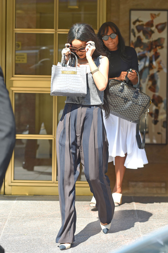 Rihanna embellished her outfit with a pair of huge Italia Independent sunglasses, and she balanced out her accessory game with a mini crocodile bag. And her two-tone pointed-toe pumps made for a classic touch, providing her with that distinctive Rihanna-level sophistication that's earned her major status in the fashion world.