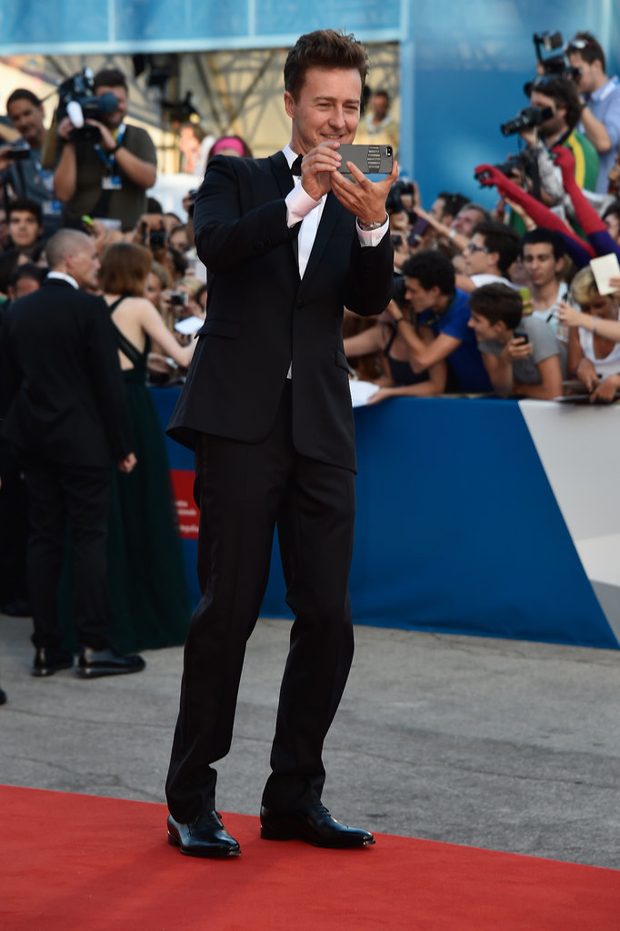 Edward took photos of the crowds on his phone at the opening ceremony.