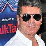 Say what?! Simon Cowell compares diaper changing to...