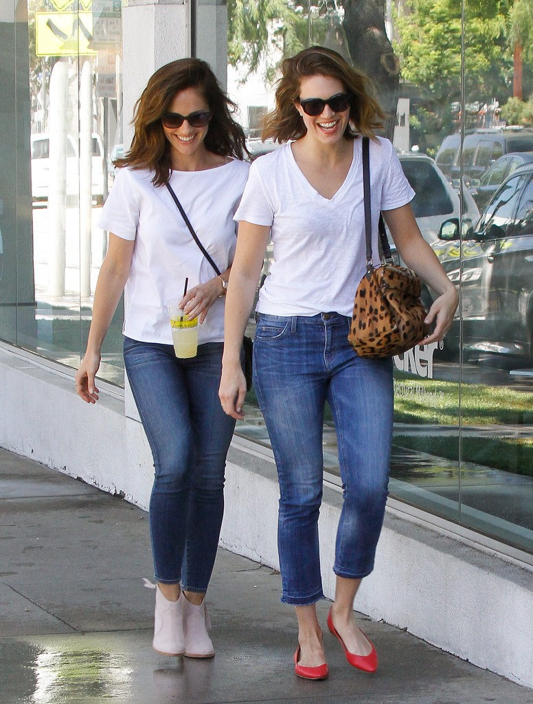 If it weren't for their unique shoes and purses, BFFs Minka Kelly and Mandy Moore would have completely matched during their smiley outing in LA on Thursday.