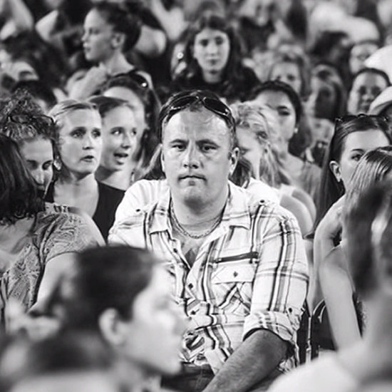 These Dads at a One Direction Concert Couldn't Be More Miserable
