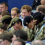 Prince Harry helps little girl at a concert
