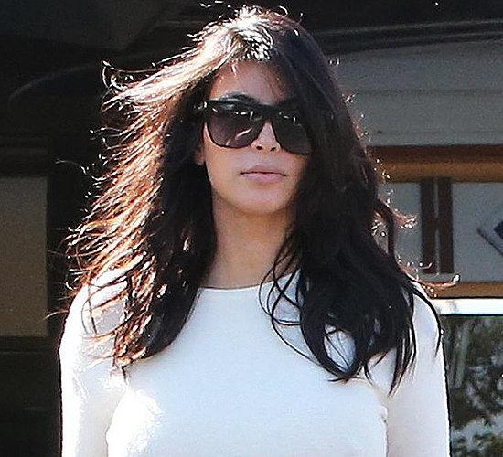 Kim Kardashian in a Backless White Shirt | Photos