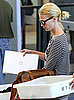 January Jones Carries a MacBook Pro at LAX