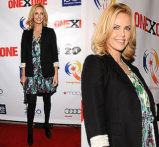 Actress Charlize Theron at the ONEXONE Foundation Gala in San Franciso Wearing a Print Dress and Black Blazer