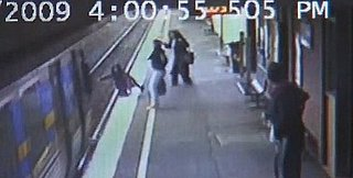 Baby Falls Onto the Train Tracks and Survives