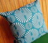 This Set of Two Aqua Pop Pillows ($30) has a cheerful, midcentury modern style.