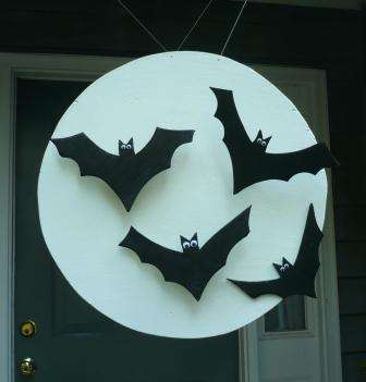 Make a batty moon to hang in your doorway out of plywood.