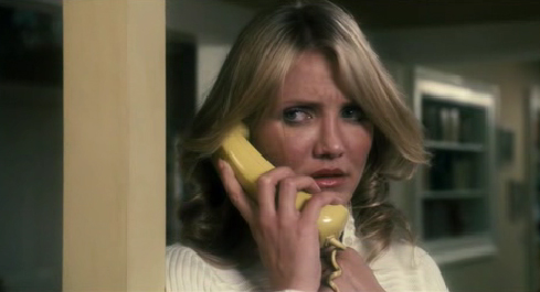 A yellow kitchen phone keeps Norma tethered to the line.
