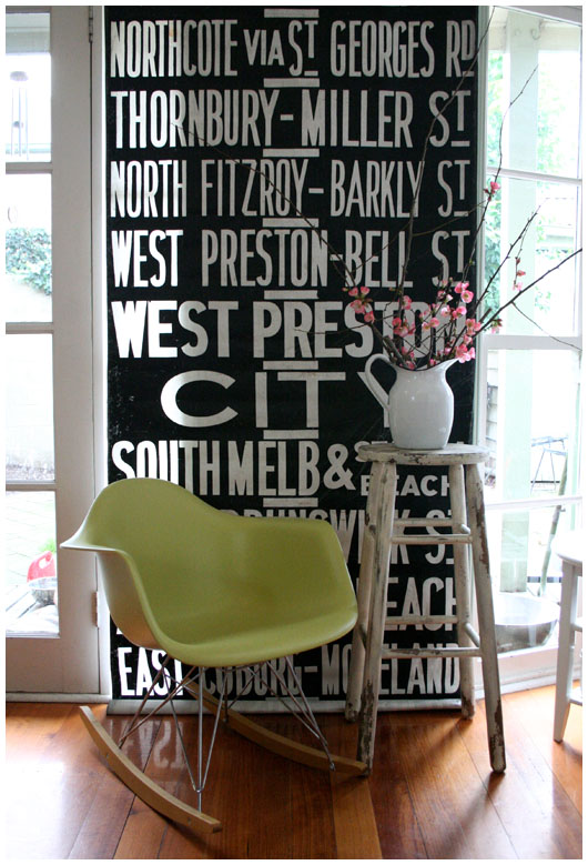 Black and white graphics define this gorgeous little nook. I love the contrast of the green rocker with the pink blossoms. Source