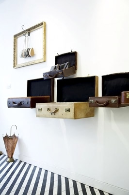 I love the look of these suitcase wall displays.  Source