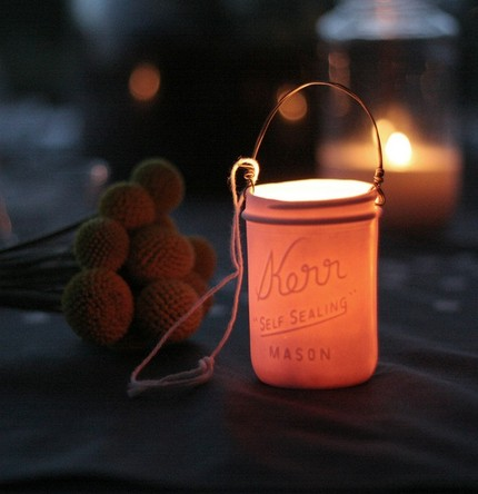 A porcelain cast of a Kerr mason jar, this Mason Jar Votive Lantern ($28) is nostalgic and gives off a lovely, warm glow.