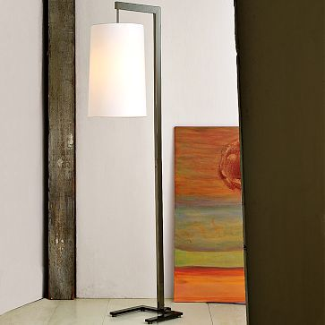 The lamp is the West Elm Modern Floor Lantern ($229).