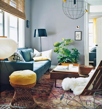 Julianne Moore used a gray with a hint of blue in her living room. This is an ideal color to mix with primary colors — see how that yellow stool pops against the blue-gray palette? Source