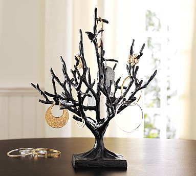 A jewelry tree, like this Butterfly Jewelry Tree ($49) is always a pretty option for displaying earrings, though you won't be able to fit a lot of pairs on the tree.