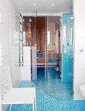 My favorite place to use turquoise is in the bathroom because it has a dreamy, sea vibe. You can't go wrong with walls or floors of small turquoise tiles. Source