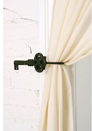 Let the sun shine in when you tie back curtains with these Key Tiebacks ($14).