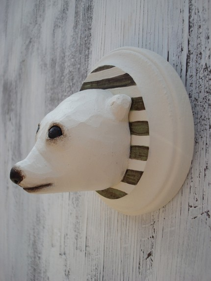 Polar Bear ($51) is a wooden wall plaque that features an adorable little bear. Perfect for a kid's room!