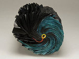 Artist Jacqueline Rush Lee made her Peacock book sculpture from a used book and hand-painted ink.