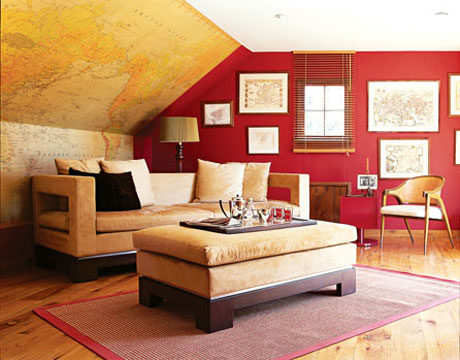 A map room's rich red wall adds depth to the space. Since the color red helps to bring text and images to the foreground, it's a perfect background color for these maps. Source