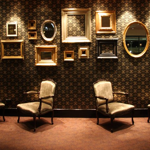 A wall of ornate gold wooden mirrors on a dark patterned wallpaper creates a really luxurious space. Very Louis Vuitton. Source: Flickr User 1Happysnapper