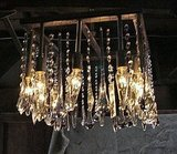 This Square Chandelier ($1,200) has a glitzy industrial look that is a bit offbeat. It would look great in a modern loft-type setting.