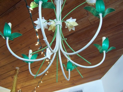 This 1950s Bouquet Chandelier ($250) is a little retro. But in the right setting, such as a powder room or girl's bathroom, it could be very playful. For a moodier look, you could paint the tole in black or charcoal.
