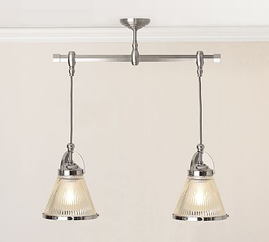 Several rows of Mini Morton Glass Pendants ($159) keep the kitchen illuminated.