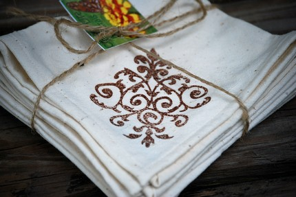 These Organic Cotton Napkins ($20 for a set of 4) are hand-stamped on unbleached organic cotton from Europe.