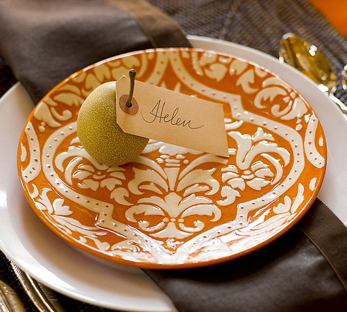 Use a manila tag around an Asian pear, or other seasonal fruit, to mark guests' settings.  Source