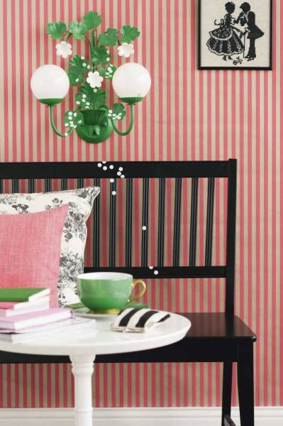 Candy-colored pink stripes add a fun twist to this space. The grass green sconce makes everything pop. Source