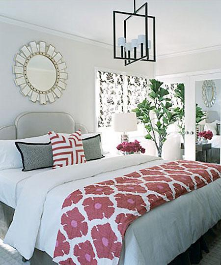 Temper pinks by using gray tones in the majority of a space. The cool grays in this bedroom mellow and calm the space. Source