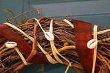 Cowrie shells create a Kwanzaa-themed wreath. Source