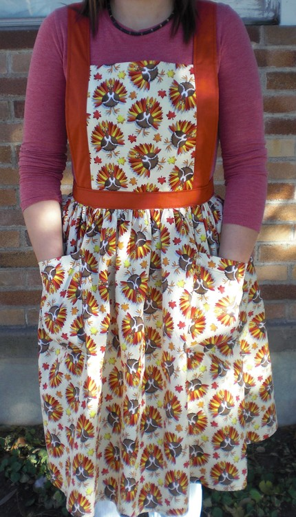 Keep your holiday garb clean and tidy by covering it with a Turkey Apron ($20).