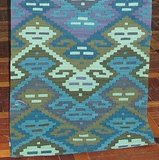 A classic Kilim ($300) goes for tranquility in sea-inspired colors.