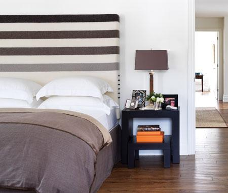 Varying shades of brown stripes give this bedroom a sporty, masculine vibe. Source