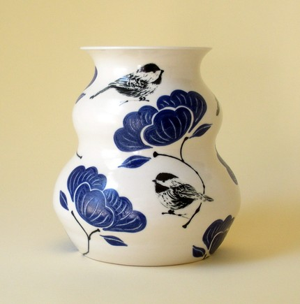 I love the colors and designs in this Blue Peony Chickadee Vase ($115). The designs are achieved with a technique called sgraffito, where clay slip is painted on and then carved away to expose the porcelain beneath.