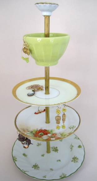 Etsy seller Whomadeit makes gorgeous jewelry stands like this 4-Tier Lime Green and Orange Blossom Antique Stand ($85.50) using hand-picked new and antique dishes.