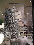 An acrylic tree is perfect for the modern city gal. Source