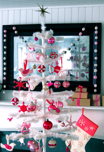 Reds and pinks really make this white artificial tree a standout. Source