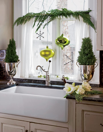 Hang ornaments in your kitchen window! Source