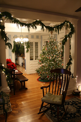 A garland entwined with holiday lights creates a living room entrance that's filled with holiday spirit. Source:  Flickr User rudy.kleysteuber