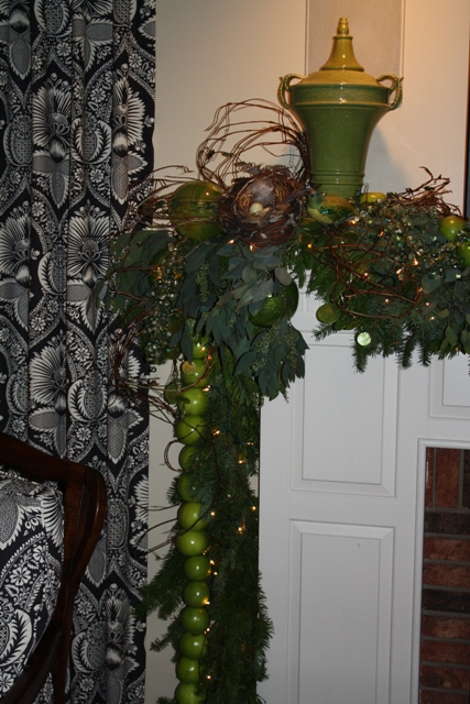 String apples onto a garland and hang them from your mantel. Source