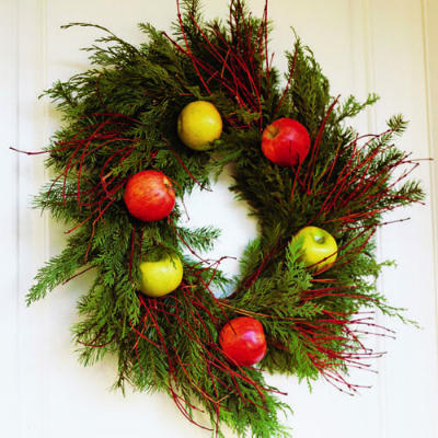 Red and yellow apples add an unexpected element to traditional holiday wreaths. Learn how to make it on Sunset.